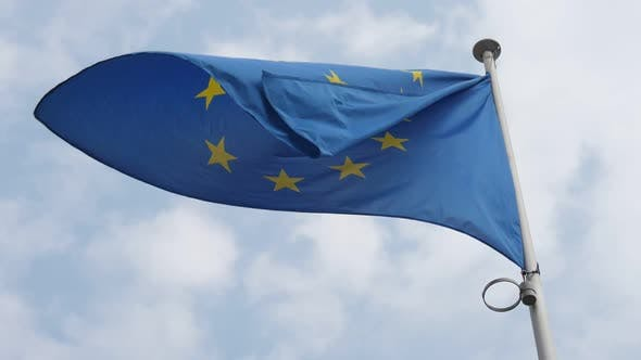 Cover Image for Blue EU Standard Fluttering in Brussels As a Symbol of Freedom in Spring in Slo-mo
