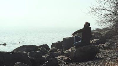 Pensive Man at the Seaside