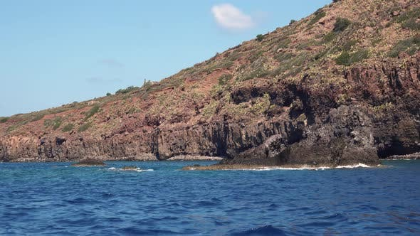 Thumbnail for White Boat in Distance Moored in Mediterranean Sea at Lipari Island. Blue Sky with White Clouds