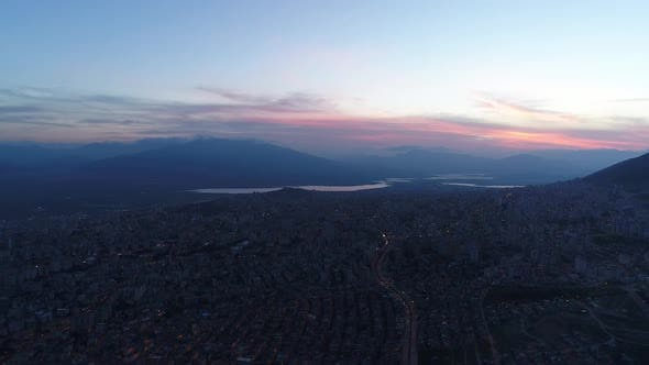 Thumbnail for City River And Mountain Aerial Sunset Clouds