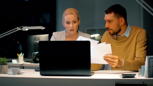 Thumbnail for Business Team with Laptop and Files at Dark Office 13