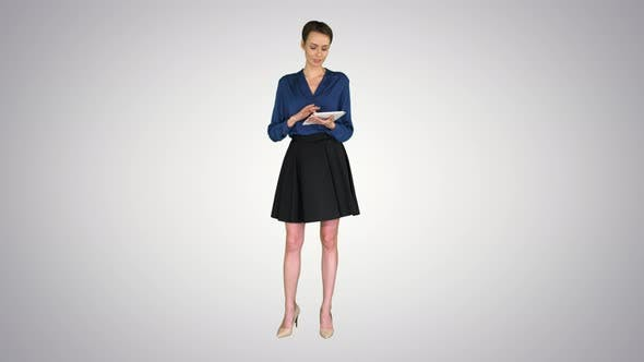 Cover Image for Lady with Short Hair Wearing Formal Clothes Holding a Tablet in Her Hands and Talking To Camera on