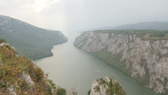 Thumbnail for Tilting on Danube river gorge and cliffs called Mali Kazan 4K 2160p 30fps UltraHD footage -  Serbian
