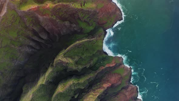Thumbnail for Picturesque Scenery of Ribbed Coastal Cliffs of Hawaii and Ocean Waves Washing Them. Aerial View