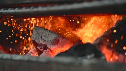 Close Up Of Some Charcoal Burning In A Grill In Slow Motion