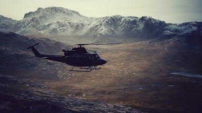 Slow Motion Vietnam War Era Helicopter in Mountains