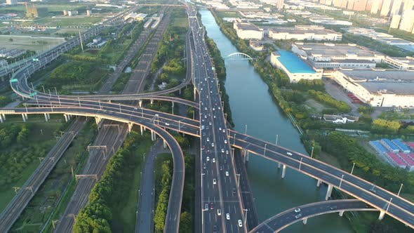 Thumbnail for Aerial Drone View of Highway Multi-level Junction Road with Moving Car at Sunset. Active Movement