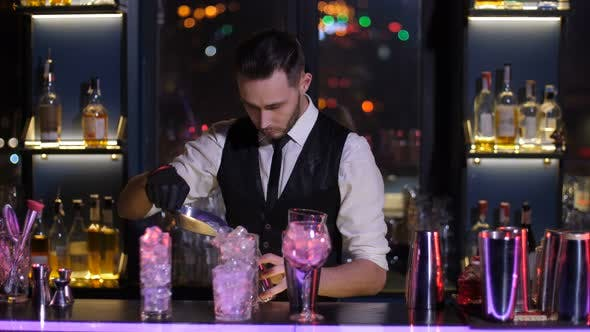 Thumbnail for Bartender Filling Glasses with Ice in Nightclub