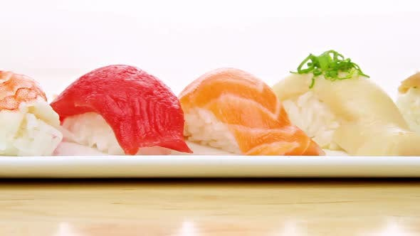 Thumbnail for Camera Moves Pass A Plate Of Sushi