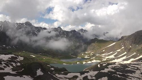 Clouds Passing Through the Valley to the High Altitude Alpine Lake