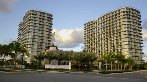 Modern condo apartments with palm trees shot with motion camera