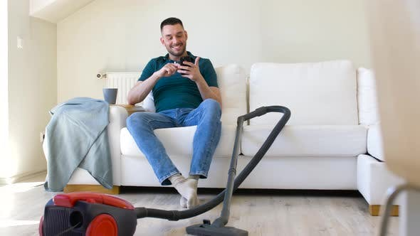 Thumbnail for Man with Smartphone and Vacuum Cleaner at Home 12