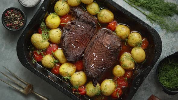 Thumbnail for Delicious Roasted Goose Breast Served with Vegetables, Potatoes. Placed in Metal Baking Dish