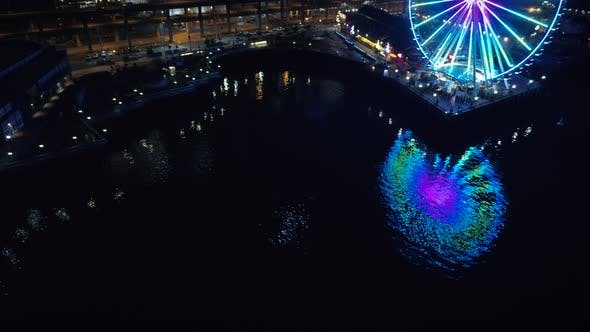 Thumbnail for Abstract Aerial View Of Ferris Wheel Reflection In Night Water