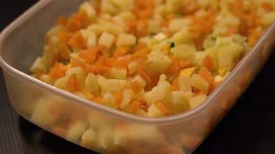 Salad in the Foreground of Carrots and Potatoes