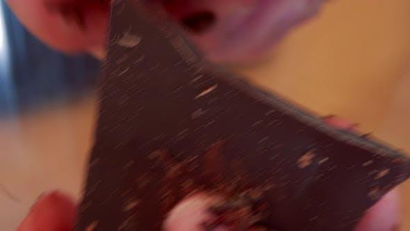 Thumbnail for A Woman Grates a Bar of Dark Chocolate with a Potato Peeler - Closeup