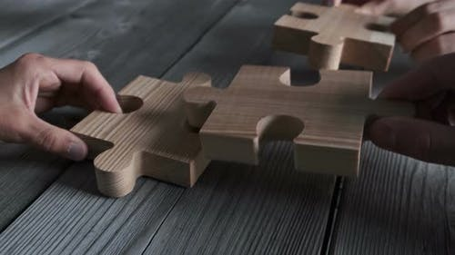 Business people and wooden puzzle