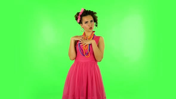Thumbnail for Girl Communicates with Someone in a Friendly Manner on Green Screen at Studio