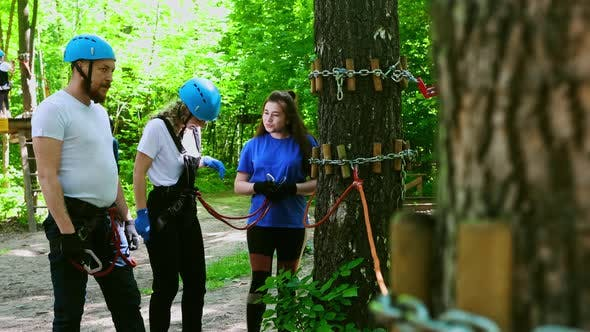 Thumbnail for Extreme Rope Adventure - Instructor Explaining To Couple How To Use Their Insurance Belts