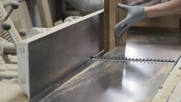 Thumbnail for Male Carpenter Using Plane in Woodworking Woodshop