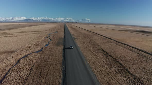 Thumbnail for Aerial View of a Moving Car on a Deserted Road in Iceland in Early Spring