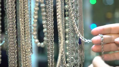 Female Fingers Choosing Jewelry