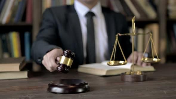 Thumbnail for Close Up Shoot of Judge Hand Bang the Gavel While Reading Book