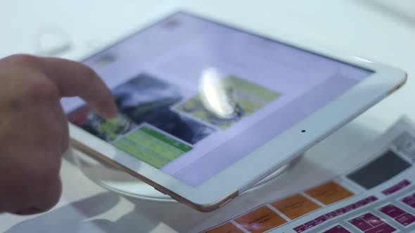 Thumbnail for Young Man Uses A Modern Tablet In The Office