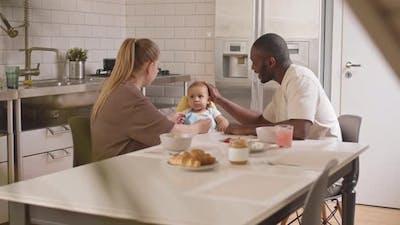 Parents Spoon Feeding Baby