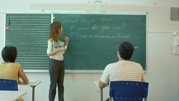 Thumbnail for Learn English Confident Beautiful Woman Teacher Chalk Blackboard