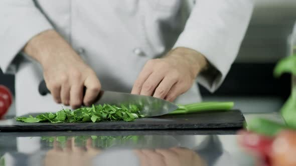 Thumbnail for Chef Hands Cutting Celeriac at Kitchen