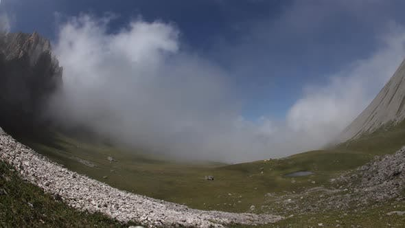Thumbnail for Time Lapse of Clouds Over Mountain Tops