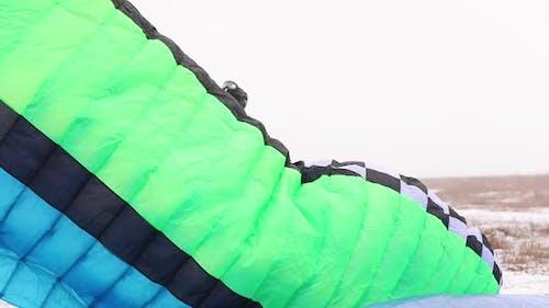 Man Paragliders Preparing Parachute for Paramotor Paraglider Gliding