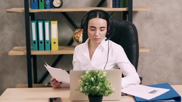 Female Call Center Worker Answers Customer Call