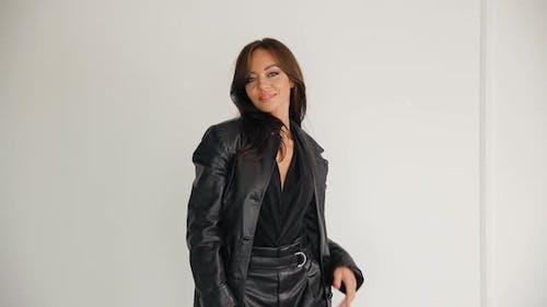 Glamour Female Model in Black Posing in Studio