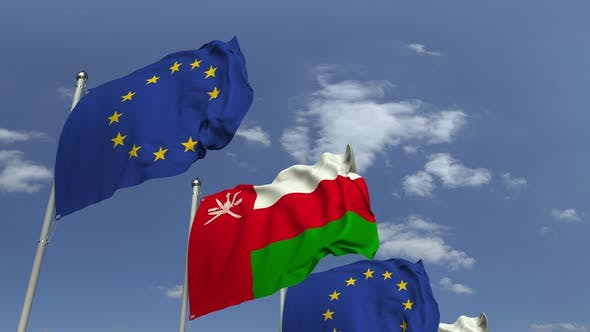 Flags of Oman and the EU at International Meeting