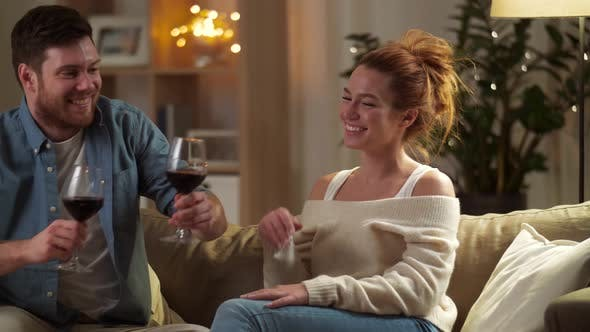 Thumbnail for Happy Couple Drinking Red Wine at Home in Evening 48