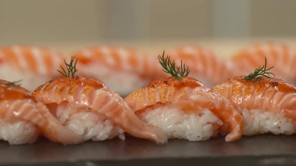 Thumbnail for Plate of prepared sushi, closeup panning shot