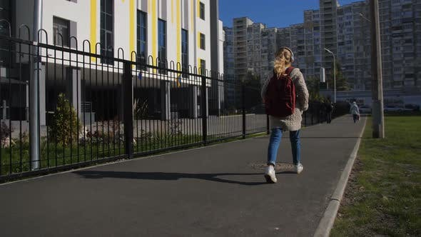 Thumbnail for Cute Schoolgirl with Backpack Going To School