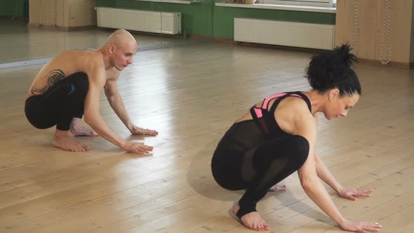 Thumbnail for Mature Couple Doing Yoga Together Indoors