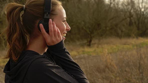 Thumbnail for Athlete Listening to Music