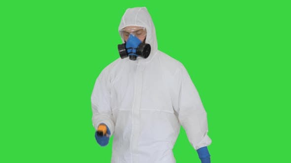 Thumbnail for Doctor in Protective Suit Checking Your Temperature on a Green Screen, Chroma Key