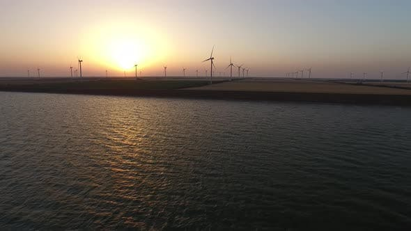 Thumbnail for Wind Turbines Alternative Bioenergy on the Background of a Golden Sunset. Aerial Survey