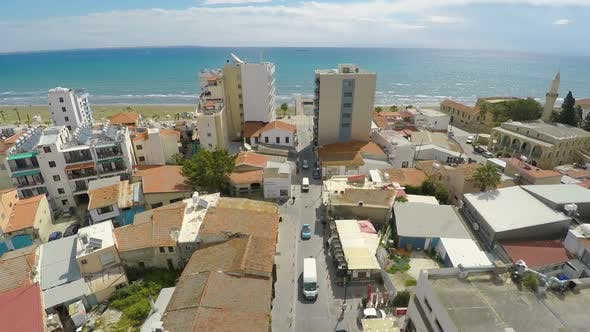 Thumbnail for Flyover Above Beautiful Resort Town on Sea Shore, Water Sparkling in Sun, Summer