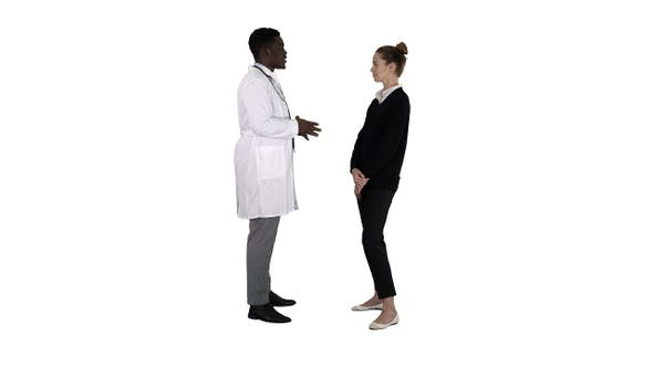 Cover Image for Male african doctor talking to female patient on white background.
