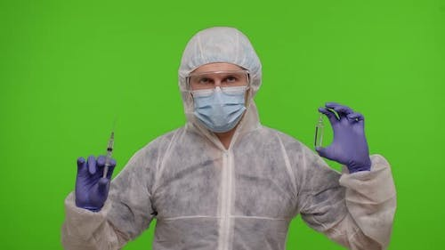 Doctor in PPE Suit with Vaccine Ampoule Syringe in Hands Offering Vaccination Against Coronavirus