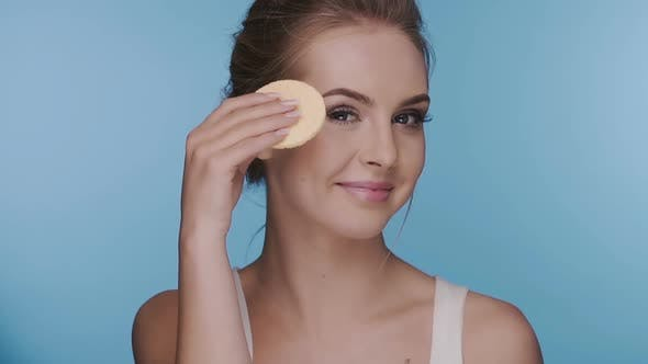 Thumbnail for Brunette Removing Make-up Showing Her Sponge Into the Camera