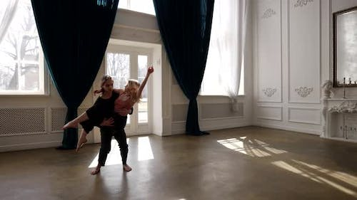 Emotional Dance of Young Loving Couple in Rehearsal Room Repetition of Contemporary Dance