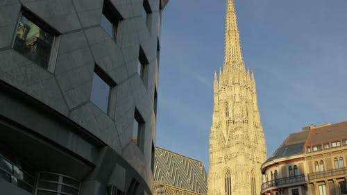 Tilt up of Stephansdom and Haas Hause