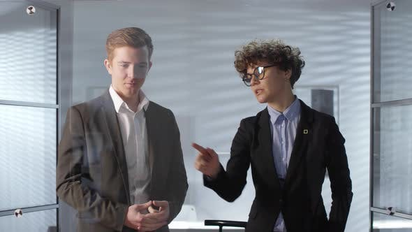 Thumbnail for Coworkers Using Invisible AR Screen and Discussing Business in Office
